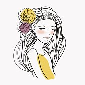 Portrait of young beautiful woman with flowers in hair