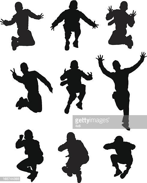 posing mid air jumping men - fighting stance stock illustrations, clip art, cartoons, & icons