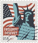 Postage stamp with Statue of Liberty and flag USA