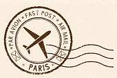 Postal stamp, round brown postmark with plane icon. Paris, France