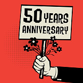 Poster in hand, business concept with text 50 years anniversary