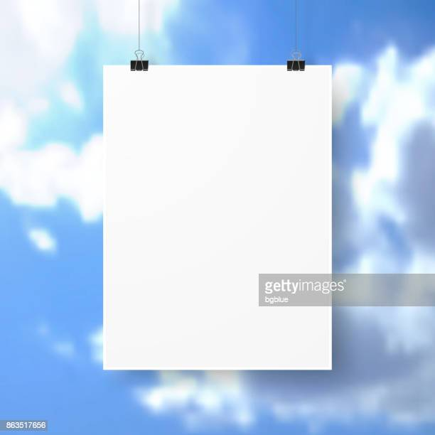 Poster template isolated on blue sky and clouds