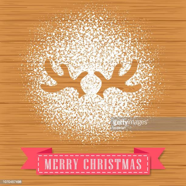 powdered sugar decorate a reindeer antler shape - icing stock illustrations