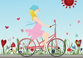 Pregnant girl rides a Bicycle on the field