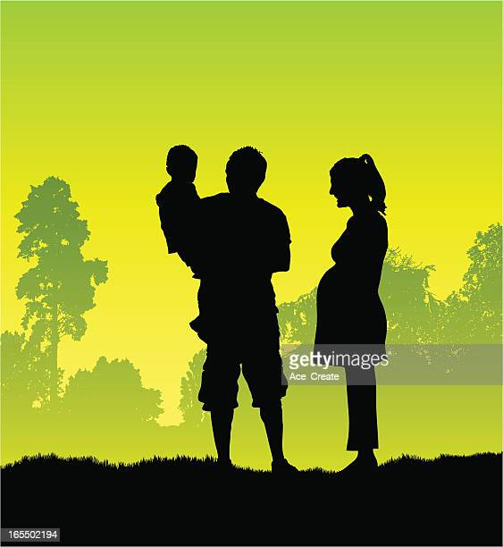Pregnant mother and family silhouette