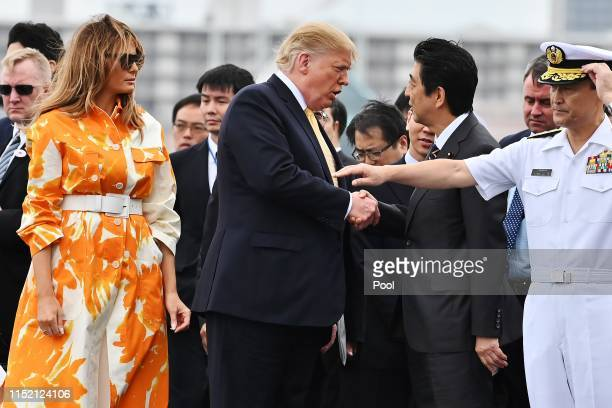 President Donald Trump and his wife Melania Trump flanked by Shinzo Abe and Akie Abe before leaving the Japan's navy ship Kaga on May 28 2019 in...