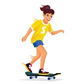 Pretty girl learning to ride a skateboard