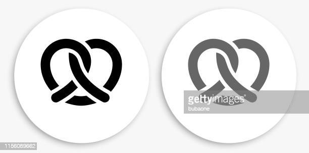 pretzel black and white round icon - pretzel stock illustrations, clip art, cartoons, & icons
