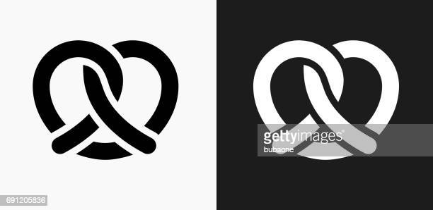 pretzel icon on black and white vector backgrounds - pretzel stock illustrations, clip art, cartoons, & icons