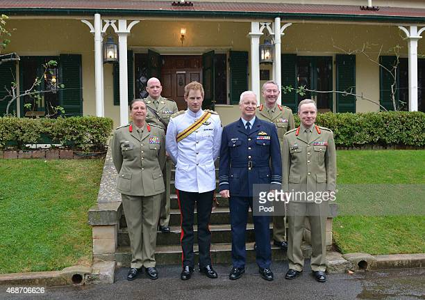 Prince Harry stands with Brigadier Dianne Gallasch Commandant RMC Warrant Officer David Ashley RSMA Australian Defence Force chief Air Chief Marshal...