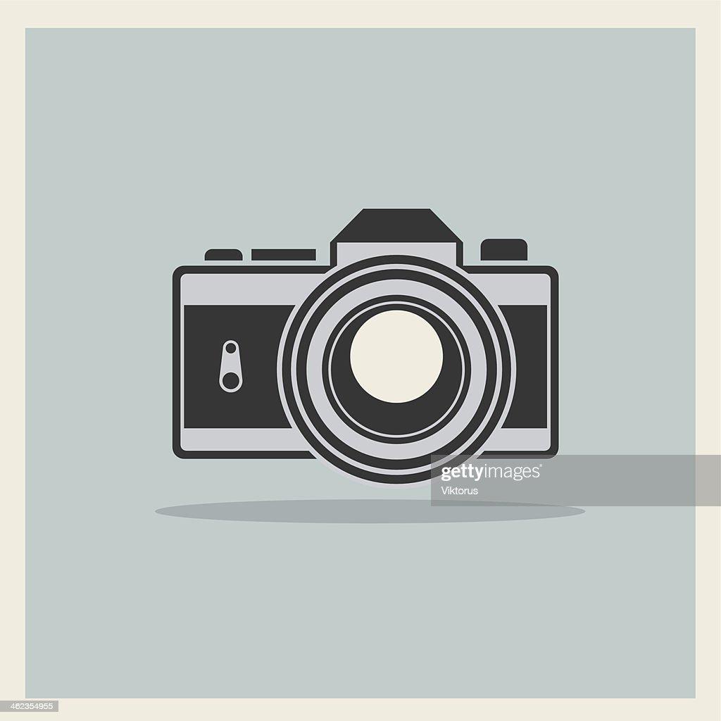 DSLR Professional Camera Icon On Retro Vintage Background