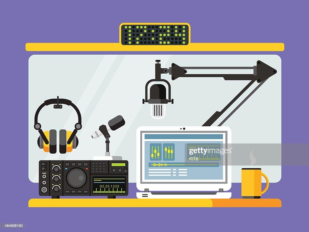 Professional radio station studio with microphones and headphones