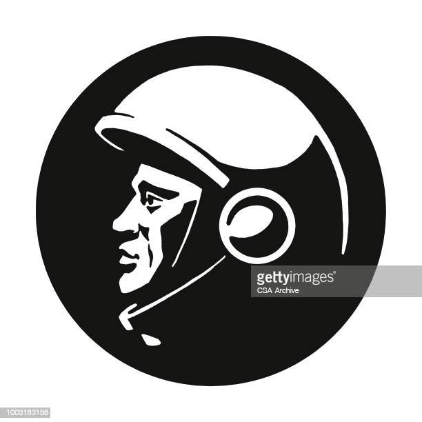 Profile of a Man Wearing a Helmet
