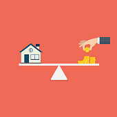 Property investment illustration. Home and stack of money on the scale. Buying a home. Real estate