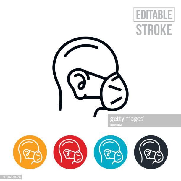 schutzgesichtsmaske dünne linie symbol - editierbarstrich - mundschutz stock-grafiken, -clipart, -cartoons und -symbole