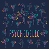 Psychedelic mushrooms set on dark background