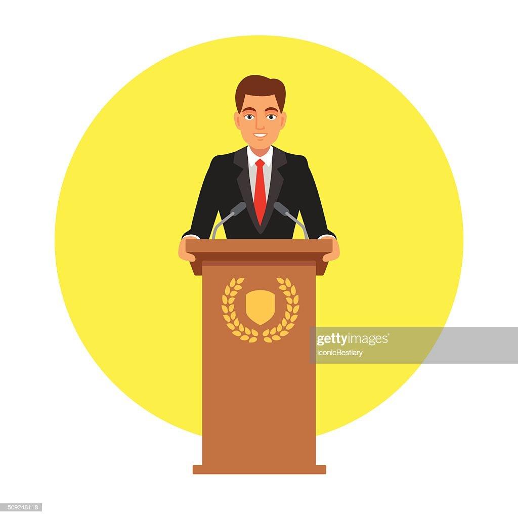 Public speaker speaking to microphones