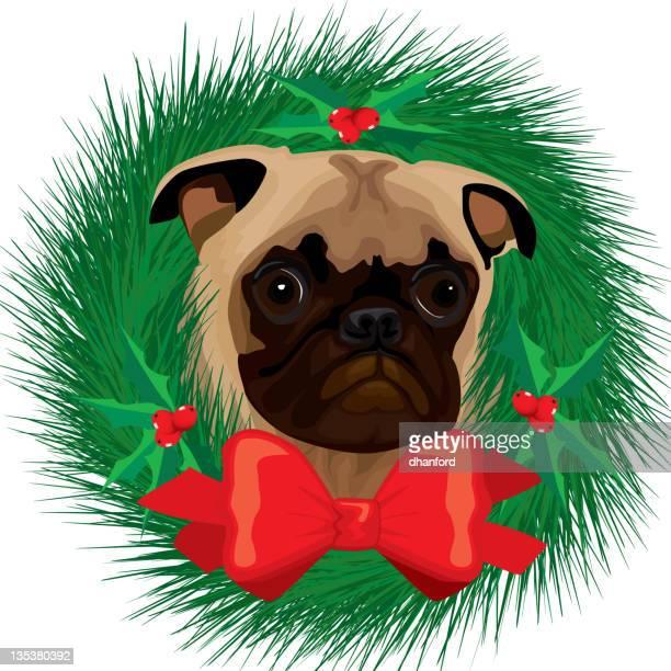 パグの顔とクリスマスのホリデーリース