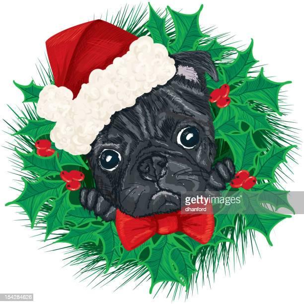 パグの顔とサンタの帽子とクリスマスのリース