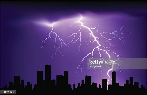 Purple and black landscape with lightning over buildings