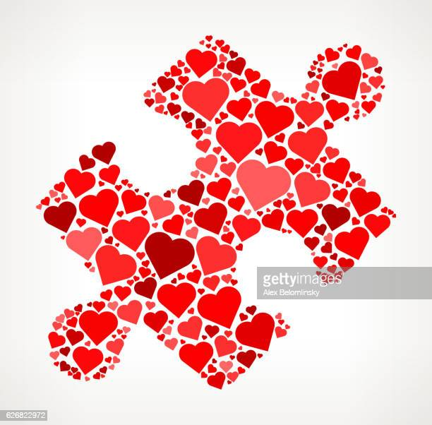 A red heart with a puzzle piece missing