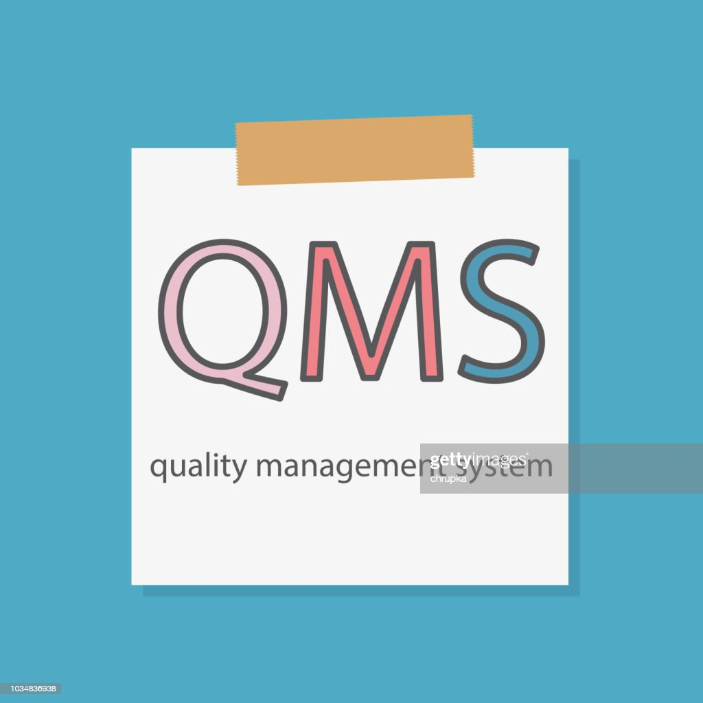 QMS Quality management system written in a notebook paper