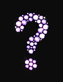 Question mark icon made with precious gems or rhinestones on black background