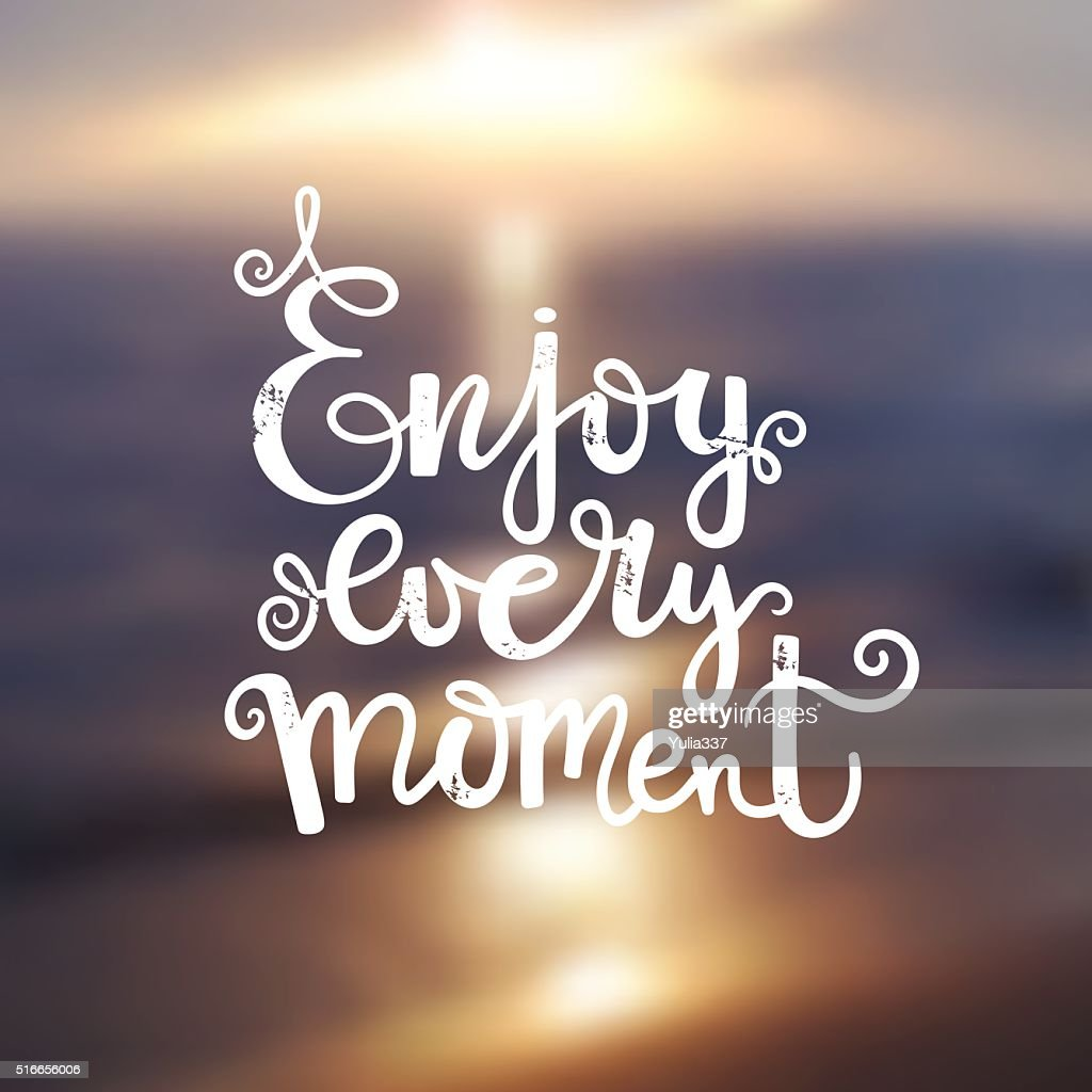 Quote - enjoy every moment on blur background