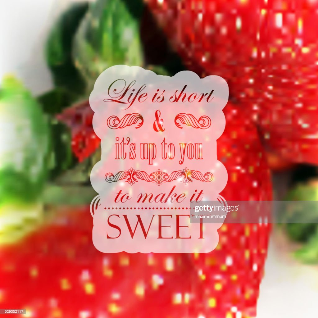Quote typographical label on realistic blurred background of ripe strawberries,