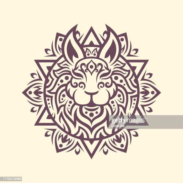 rabbit head silhouette with mandala tracery in ethnic oriental style - hindu god stock illustrations