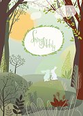 Rabbits in the spring forest