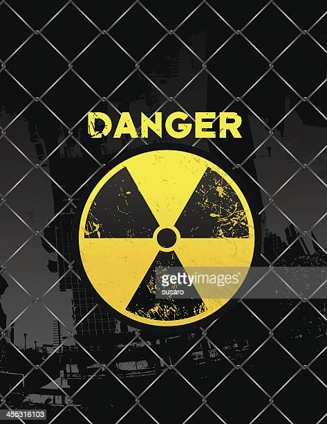 radioactive icon on wired fence - nuclear fallout stock illustrations