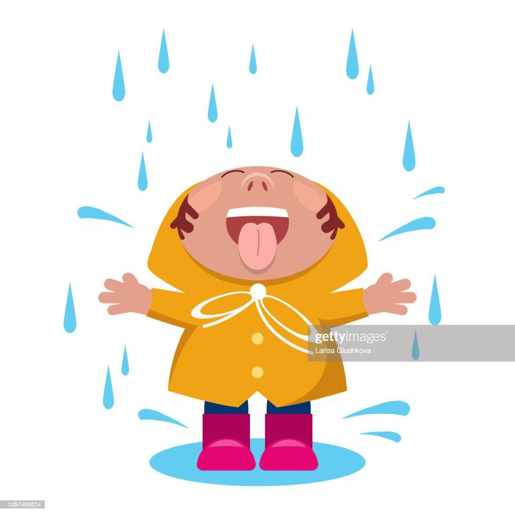 Rain. The child rejoices under the raindrops