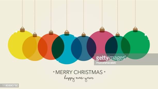 rainbow coloured simple christmas balls background - christmas ornament stock illustrations