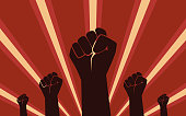 Raised Fist Hand Protest in flat icon design on red color ray background