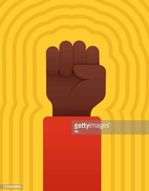 raised fist - black civil rights stock illustrations