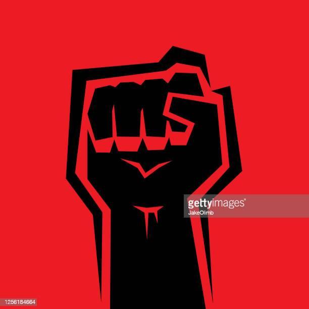raised fist - fist stock illustrations