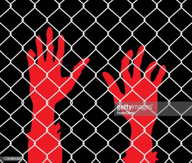 raised hands chainlink fence - anti quarantine protest stock illustrations