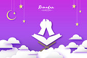 Ramadan Kareem Greeting card with Symbol of Islam - Crescent Moon The holy book of the Koran on the stand. Paper cutHoly month of muslim. Islamic festival. Purple