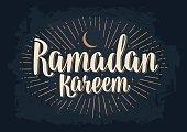 Ramadan kareem lettering with rays, moon and stars