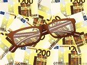 reading glasses on two hundred euro background