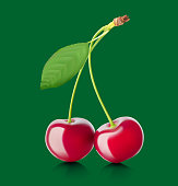 Realistic cherry with a green leaf on color background.