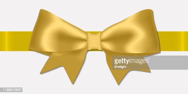 realistic decorative shiny satin golden ribbon bow, isolated on white background. - tied up stock illustrations