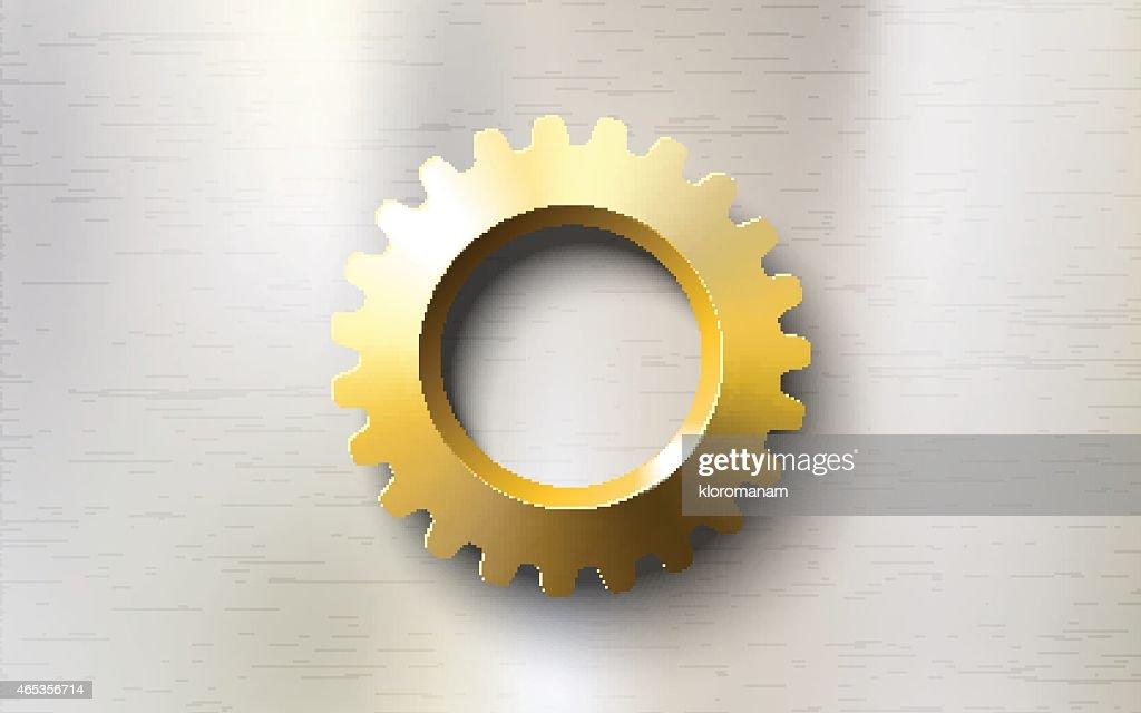 realistic golden gear on a steel background