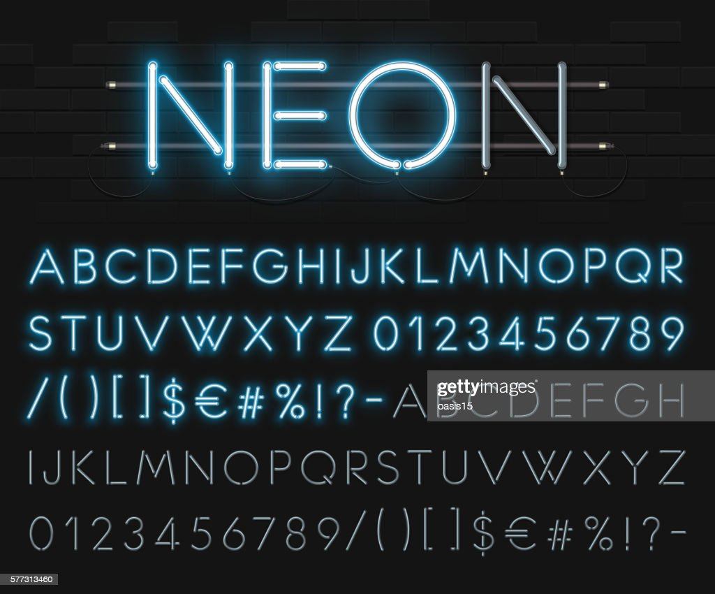 Realistic neon alphabet on a background of black brick wall.