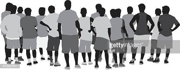 Rear view of men standing