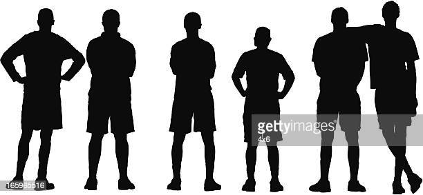 Rear view of sports team standing in a row