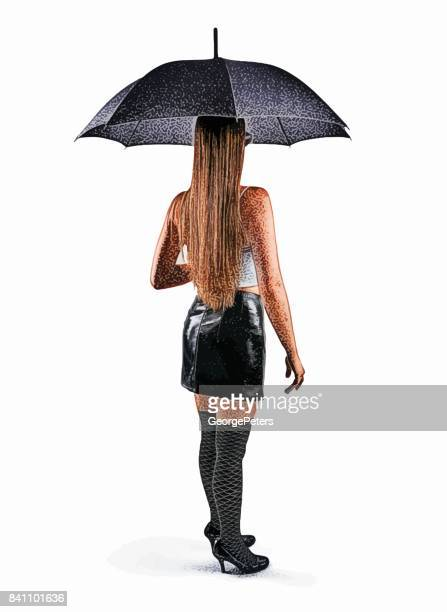 Rear view of woman holding umbrella wearing patent leather mini skirt, crop top and thigh highs