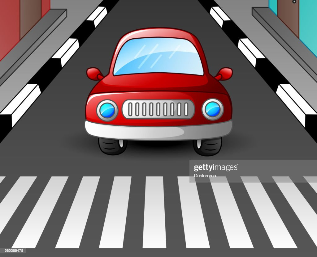 Red car stopped at the zebra crossing