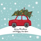 Red car with Christmas tree on the winter background.